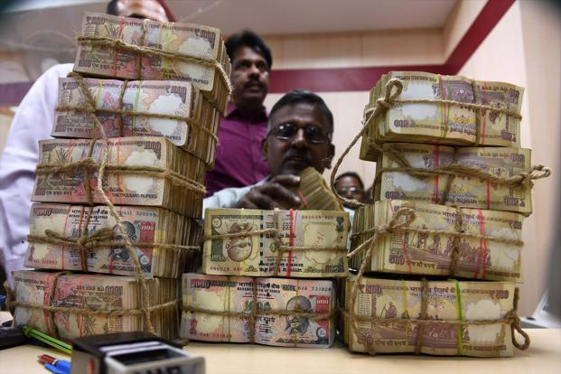 The pitch for demonetisation was that the bulk of Rs 500 and Rs 1000 notes were stored as black money, besides being easily counterfeited to fund illegal activities. Photo: PTI