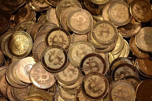 Following PBOC's announcement on Monday, bitcoin tumbled 11.4%, the most since July, to $4,326.75, while the ethereum cryptocurrency slipped more than 16%. Photo: AFP