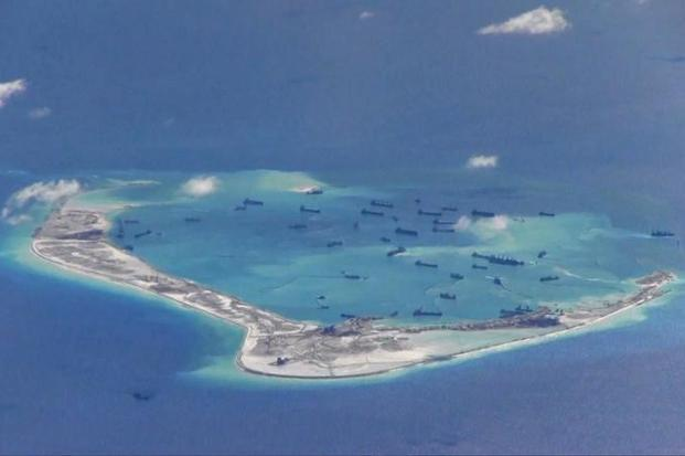 File photo. Last month, a Philippine lawmaker released photos he said showed Chinese fishing, coast guard and navy vessels surrounding a Philippine-occupied isle in the Spratly island chain, preventing planned repairs to a runway. Photo: Reuters