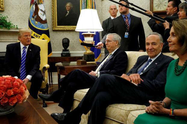 US President Donald Trump meets with Senate majority leader Mitch McConnell (2nd Left), Senate Democratic leader Chuck Schumer (2nd right), House minority leader Nancy Pelosi (right) and other congressional leaders in the Oval Office of the White House. Photo: Reuters