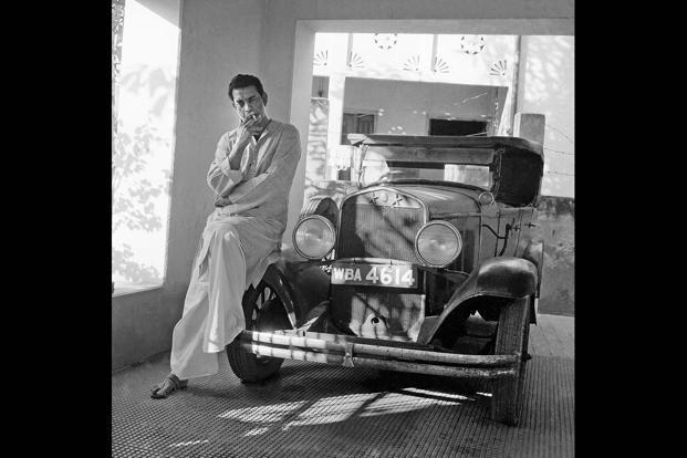Satyajit Ray with the vintage 1930 Chrysler used in 'Abhijan', Kolkata. Photoshoot for 'Filmfare', 25 January 1965.