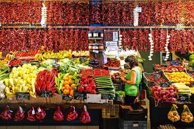 A vegetable market stand in Budapest displays strings of paprika. Photo: Alamy.