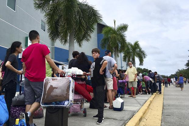 Thousands of people wait in line to get into a Hurricane Irma shelter at the Germain Arena in Estero, Florida, on Saturday. Photo: AP