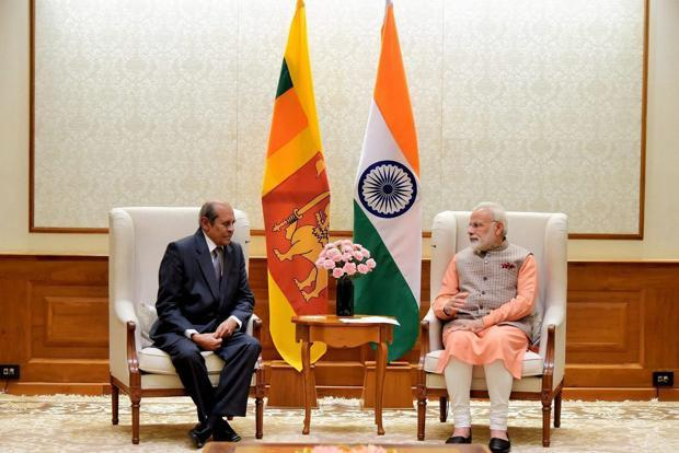 Prime Minister Narendra Modi with Sri Lankan foreign minister Tilak Marapana at a meeting in New Delhi on Saturday. Photo: PTI