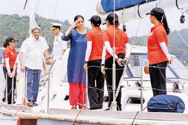 Defence minister Nirmala Sitharaman and Goa chief minister Manohar Parrikar with members of an all-woman crew of INSV Tarini, a sailboat that plans to circumnavigate the globe in 165 days, in Panaji on Sunday. Photo: PTI
