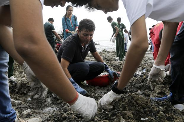 Afroz Shah participates in clean up drive at the Versova beach on the Arabian Sea coast in Mumbai, India. Photo: AP