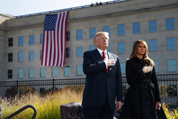 Donald Trump and first lady Melania Trump stand as Taps is played during a ceremony to mark the anniversary of the 11 September terrorist attacks, on 11 September 2017, at the Pentagon. Photo: Evan Vucci/AP