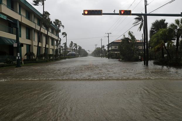 Water floods a street in the business district as Hurricane Irma passes through Naples, Florida, Sunday. Photo: AP