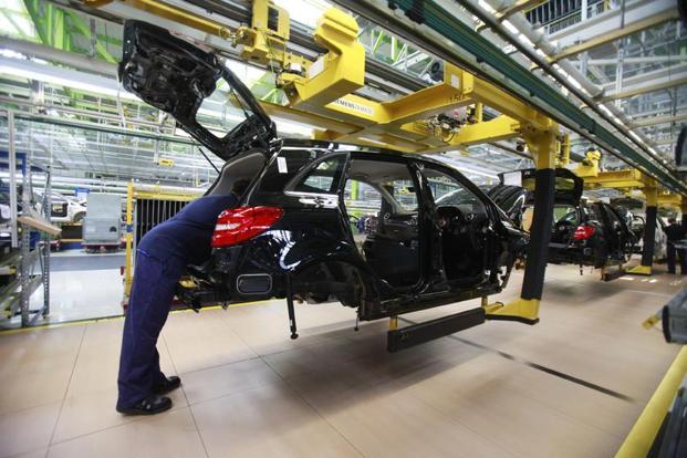 Employee of German car manufacturer Mercedes Benz works on a Mercedes B-class car at the Mercedes plant in Rastatt. Photo: Reuters