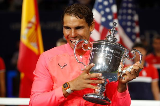 Rafael Nadal of Spain with the US Open trophy after defeating Kevin Anderson of South Africa, in the final at New York on Sunday. Photo: Reuters