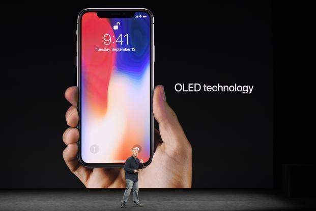 The Apple iPhone X features an edge-to-edge display, no home button, Face ID that works in the dark, and enhanced AR capabilities. Photo: Bloomberg
