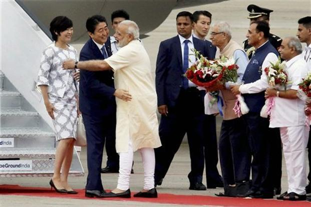 Prime Minister Narendra Modi receives his Japanese counterpart Shinzo Abe along with his wife Akie Abe at the Ahmedabad airport on Wednesday. Photo: PTI