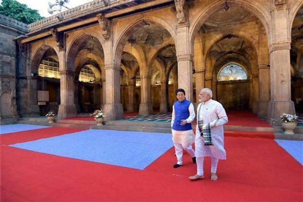 PM Narendra Modi and Japan's Shinzo Abe during a visit to the Sidi Saiyyed Mosque in Ahmedabad on Wednesday. Photo: PTI