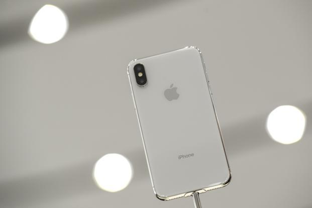 With a base price of $999 for the 64 gigabyte version, the iPhone X boasts a brighter and more energy-efficient OLED display screen. Photo: Bloomberg