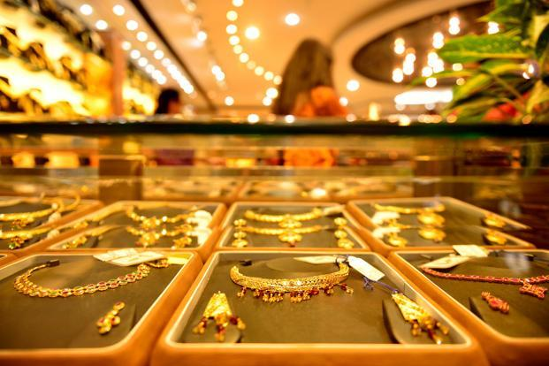 In New Delhi, gold of 99.9% and 99.5% purity tumbled by Rs500 each to Rs30,350 and Rs30,200 per ten grams, respectively. Photo: Mint