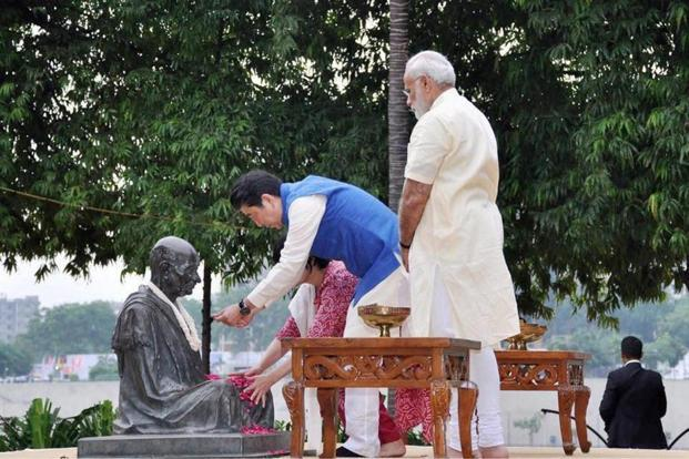 Prime Minister Narendra Modi looks on as Japanese Prime Minister Shinzo Abe and his wife Akie pay tributes to Mahatma Gandhi, at Sabarmati Ashram in Ahmedabad on Wednesday. Photo: PTI