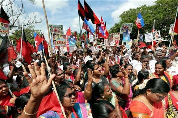 Members of DMK Party, Congress Party, Viduthalai Siruthai Katchi Party, CPI, CPM, during a joint protest against NEET Exams, in Coimbatore on Wednesday. Photo: PTI