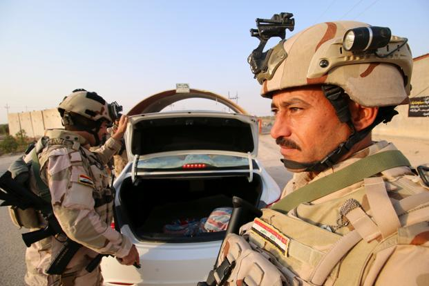 Death toll reaches 50 in twin attacks in southern Iraq