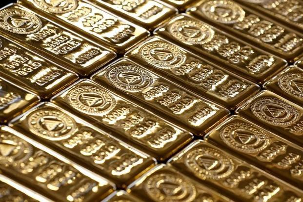 Spot gold was down 0.5% at $1,323.21 an ounce by 4.00pm, after hitting more than 1% down for the week. Photo: Reuters