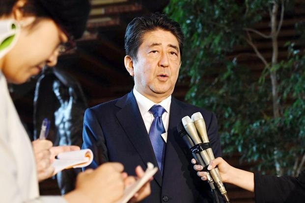 Japan's Prime Minister Shinzo Abe speaks to reporters at his official residence in Tokyo on Friday, following North Korea's missile launch. Photo: AP