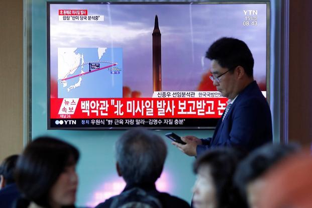 People watch a TV broadcasting a news report on North Korea firing a missile that flew over Japan's northern Hokkaido far out into the Pacific Ocean, in Seoul, South Korea on 15 September 2017. Photo: Reuters