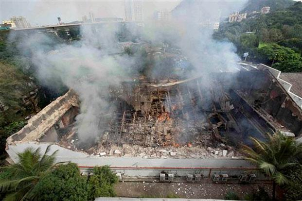 Smoke rises from the burnt out RK Studio after a fire, in Mumbai on Saturday. Photo: PTI