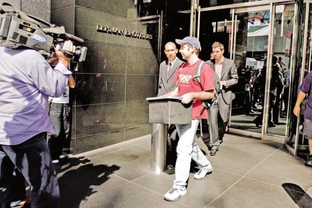 A file photo of an employee leaving the Lehman Brothers Holdings Inc. headquarters after the company filed for bankruptcy in 2008. The economics profession has faced a mounting tide of criticism in the wake of the global financial crisis. Photo: Bloomberg