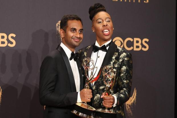 Aziz Ansari (left) and Lena Waithe won for writing the script of 'Master of None'. Waithe made history as the first black woman to win for writing for a comedy series.