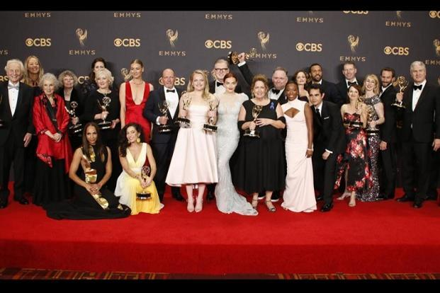 'The Handmaid's Tale' cast and crew pose with their Emmys. Hulu's series, based on Margaret Atwood's novel, won five Emmy awards, including best actress for Elisabeth Moss.