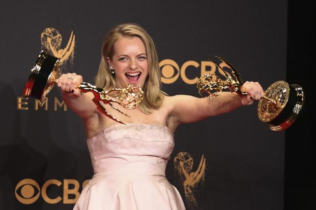Elisabeth Moss poses with her Emmy trophies for best actress in a drama series and best drama series for 'The Handmaid's Tale'.
