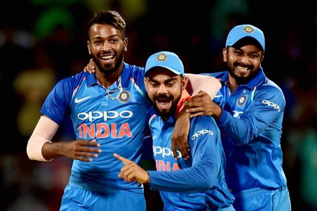 Hardik Pandya, left, celebrates with captain Virat Kohli, centre, during the first One-Day International cricket match in the ongoing India-Australia series at M. A. Chidhambaram stadium in Chennai on Sunday. Photo: PTI