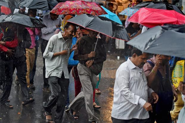 Mumbai rains: airport operations hit, 'dabbawalas' cancel deliveries