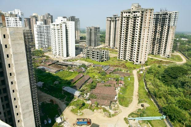 how to avoid tax on sale of property in india