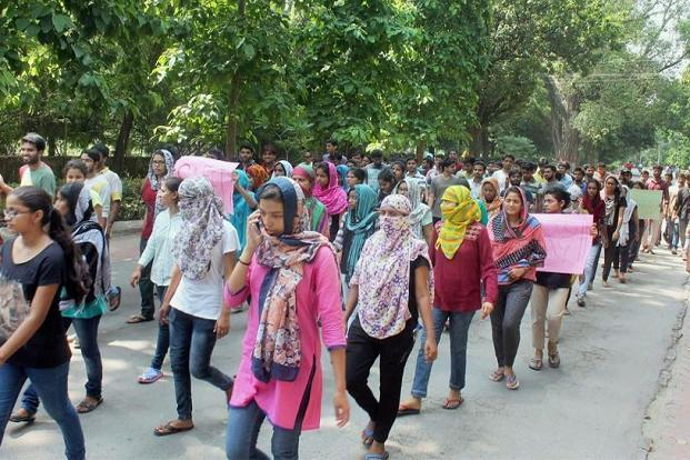 Students taking out a protest rally on the BHU campus in Varanasi on Sunday against the police's action on agitating students on Saturday. Photos: PTI