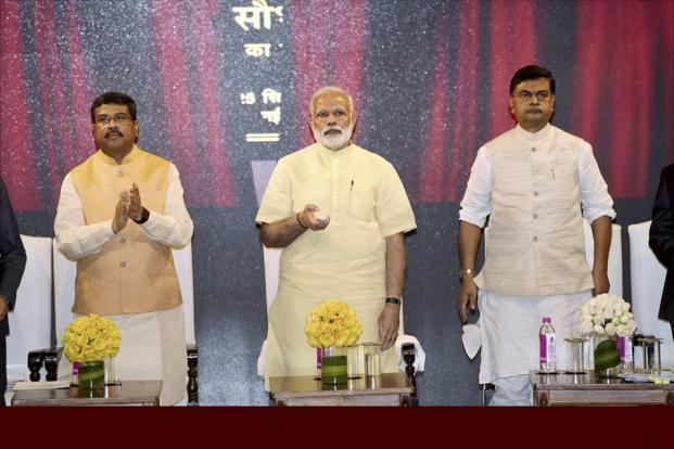 PM Narendra Modi (centre) launched the Saubhagya scheme to supply electricity to poor households, in New Delhi on Monday. Photo: PTI