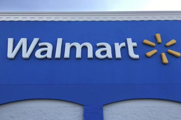 File photo. Walmart will allow members to shop from their premises in four ways—through its website, mobile app, call centre and kirana relationship managers. Photo: Swayne B. Hall/AP