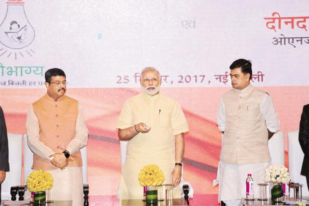 Prime Minister Narendra Modi with petroleum minister Dharmendra Pradhan (left) and power minister R. K. Singh at the launch of the Rs16,320-crore Saubhagya scheme last week. The scheme is expected to provide electricity connections to over 40 million families in rural-urban areas by December 2018. Photo: PTI