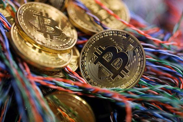 Currently, there isn't much regulatory clarity globally regarding initial coin offerings. Photo: Bloomberg