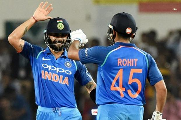 Indian opener Rohit Sharma being congratulate by Captain Virat Kohli after completing his century during the 5th ODI cricket match against Australia at Vidarbha Cricket Association Stadium, in Nagpur on Sunday. Photo: PTI