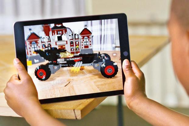 AR takes the visuals of the real world around you, and augments them with computer-generated objects and elements.