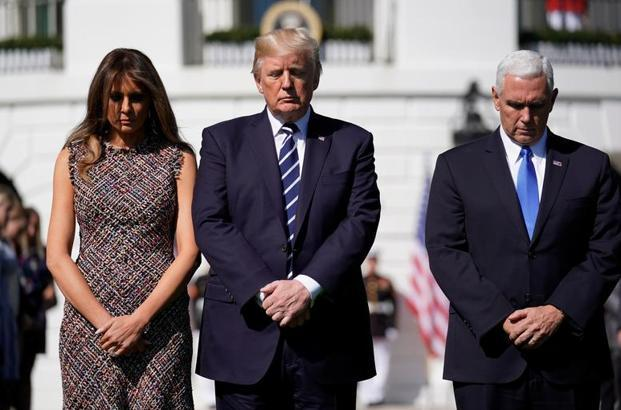 US President Donald Trump, first lady Melania Trump and vice-president Mike Pence during a moment of silence in the wake of the mass shooting in Las Vegas at the White House in Washington on Monday. Photo: Reuters (Reuters)