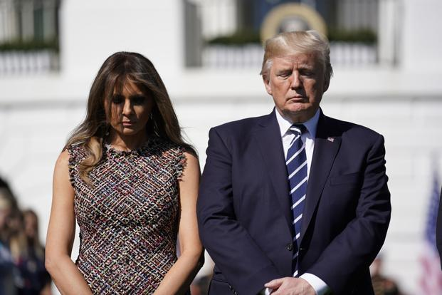 US President Donald Trump stands with first lady Melania Trump as he leads a moment of silence in the wake of the mass shooting in Las Vegas. Photo: Reuters (Reuters)