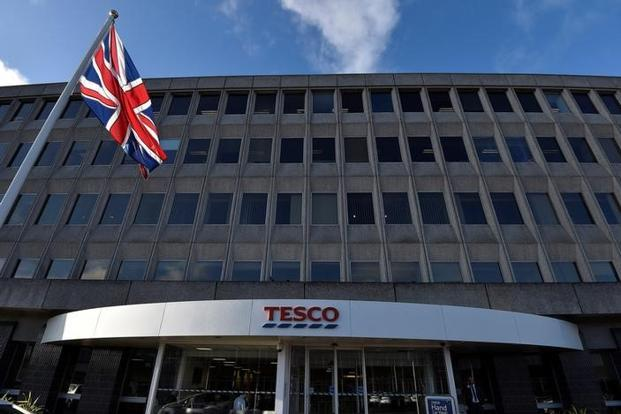 Tesco reinstates dividend as half-year profits swell to £562m
