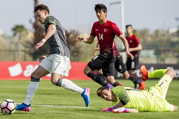Berke Özer (left) of Turkey in action against Germany during the Uefa U-17 elite round match in March. Photo: Getty Images
