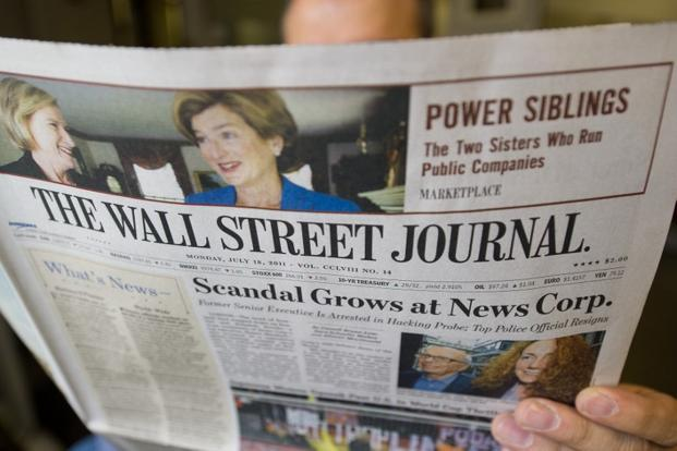 A report suggests that digital subscriptions of The Wall Street Journal were on the rise and WSJ plans to focus on encouraging customers in Asia and Europe to read the paper online. Photo: AFP
