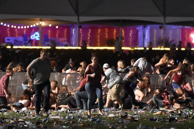 A file photo. People run from the Route 91 Harvest country music festival after gun fire started in Las Vegas, Nevada, around the Mandalay Bay Resort and Casino. Photo: AFP (AFP)