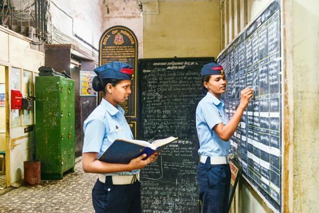 Firewoman Chhaya Pawar (right) updating the duty roster at Byculla.