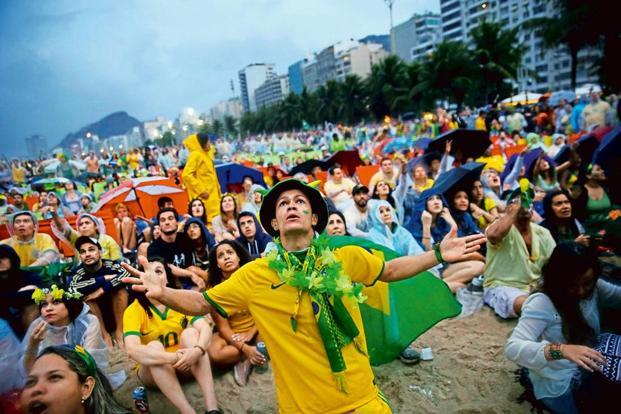 Brazil fans watching the semi-final match between Brazil and Germany on 8 July 2014 at Copacabana Beach. Photo: Getty Images