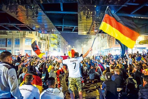 Fans celebrating Germany's victory in the Fifa World Cup 2014 in the streets of Berlin. Photo: iStockphoto