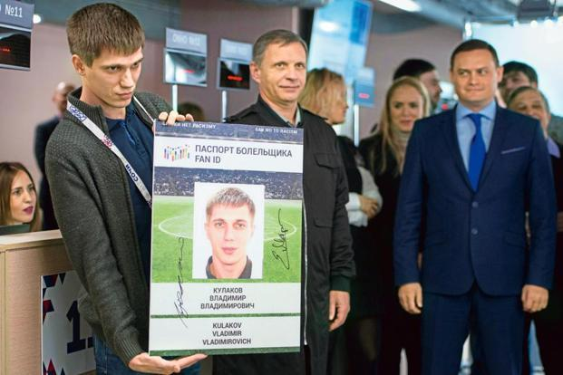 Vladimir Kulakov receiving the first 2017 Fifa Confederations Cup fan passport (Fan ID) in Sochi. Photo: Alamy